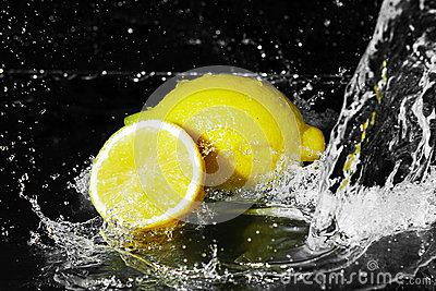 Fresh water drops on lemon on black
