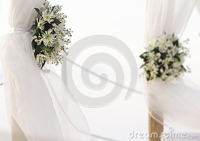 Fresh white flowers as wedding decoration on beach
