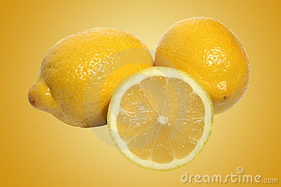 Fresh whole and sliced lemons