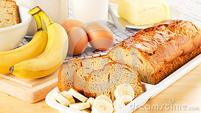 Freshly baked banana bread and ingredients