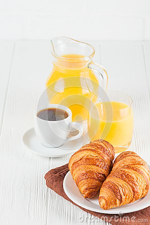 Free Freshly Baked Croissant, Orange Juice, Fresh Fruits, Jam On White Wooden Background. French Breakfast. Fresh Pastries For Morning. Stock Photos - 106111943