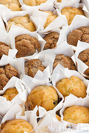 Freshly baked small muffins cakes in rows