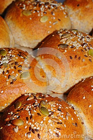 Wholemeal rolls topped with seeds.