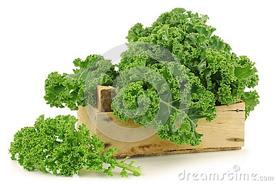 Freshly harvested  kale cabbage in a wooden crate