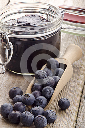 Freshly picked blueberries on a wooden spoon