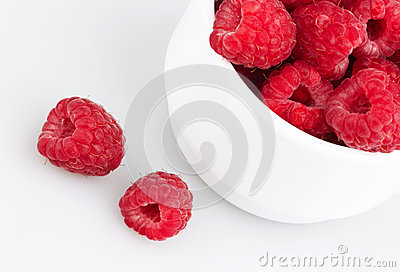Freshly picked ripe red raspberries, isolated on white