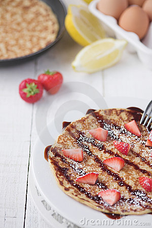 Freshly prepared crepes with strawberries