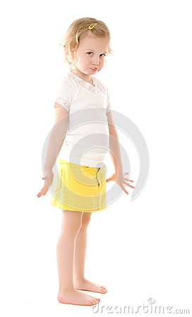 Fretful little girl standing on white background