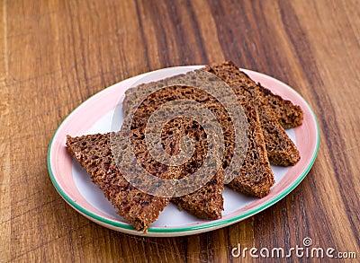 Fried black bread slice