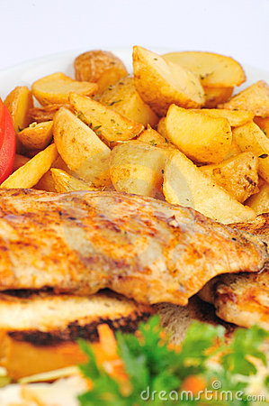Fried chicken breast with fries and salad