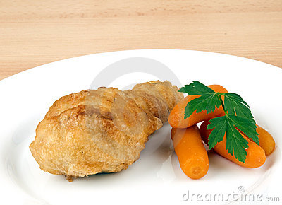 Fried chicken leg with baby carrots