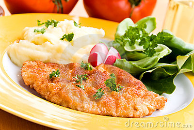 Fried cutlet - schnitzel - with puree and salad