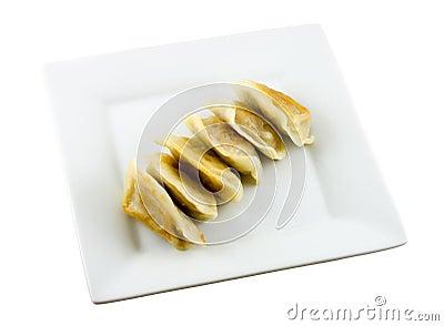 Fried dumplings on plate