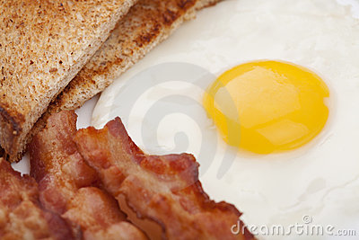 Fried egg with bacon and toast