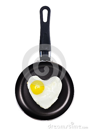 Fried egg heart shape in a pan