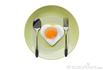 Fried egg heart and spoon