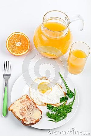 Fried egg and a jug of orange juice