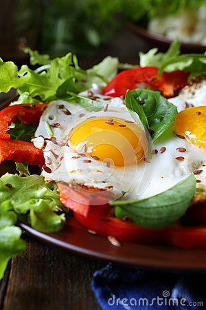 Fried eggs with fresh peppers and herbs