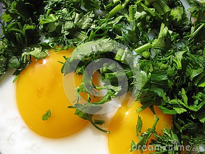 Fried eggs and greenery