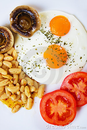 Fried eggs with mushrooms, beans and tomato