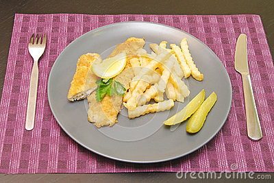 Fried fish and chips on the plate for dinner