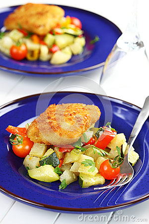 Fried fish fillet on vegetables