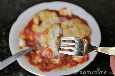 Fried fish fillets with tomato sauce