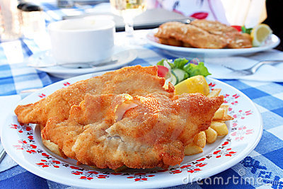Fried fish with potato on the plate