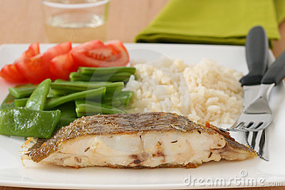 Fried flounder with rice and vegetables