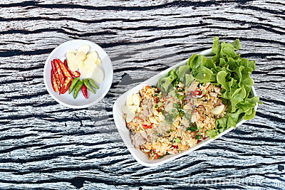 Fried garlic rice with minced pork served spicy filling side dish. Stock Photo