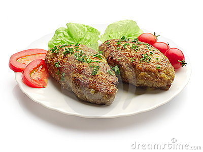 Fried meatballs with salad, dill and tomatoes