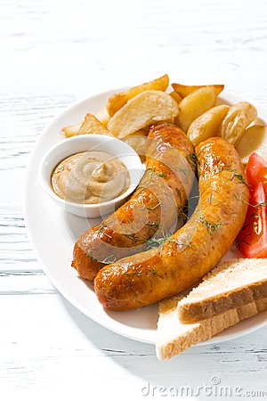 Free Fried Pork Sausages With Potatoes And Mustard Royalty Free Stock Photography - 108879587