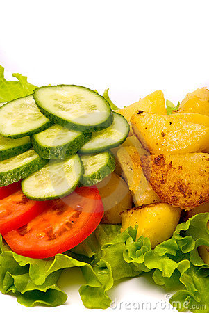 Fried potatoes with fresh cucumbers and tomatoes