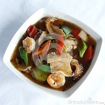 Fried rice noodles with fish cutlet and shrimps in black for Fish in black bean sauce