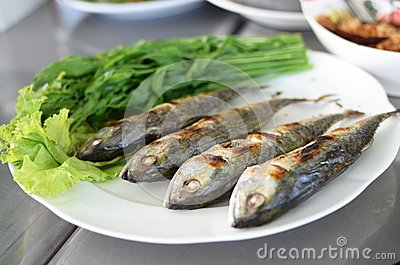 Fried sardine on plate in Asian restaurant