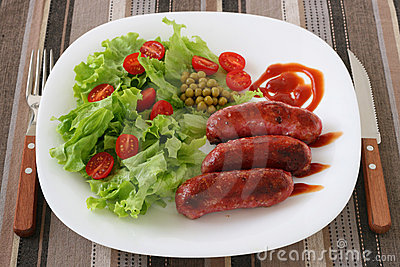 Fried sausages with salad