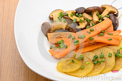 Fried Shiitake mushroom, carrot and potato with butter sauce