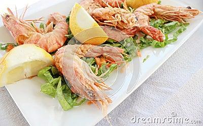 Fried shrimp with salad