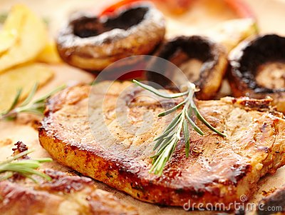Fried tenderloin and grilled mushrooms