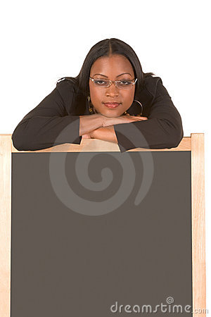 Friendly adult student leaning on chalk board