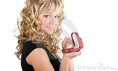Friendly blond girl holding a wedding ring