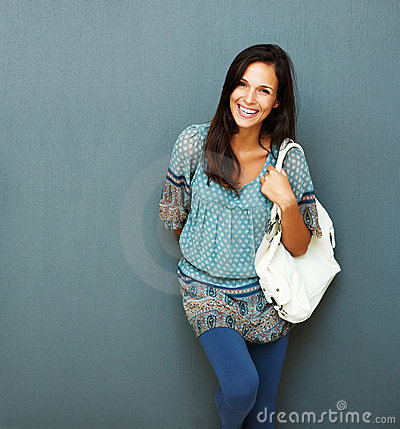 Friendly brunette with purse on her shoulder
