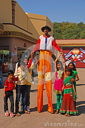 Free Friendly Clown On Stilts Smiling Widely While Posing With Children At Ramoji Film City - World`s Largest Film Studio Complex Stock Images - 98155974