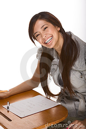 Free Friendly Excited Asian College Student By Desk Royalty Free Stock Photos - 10117238
