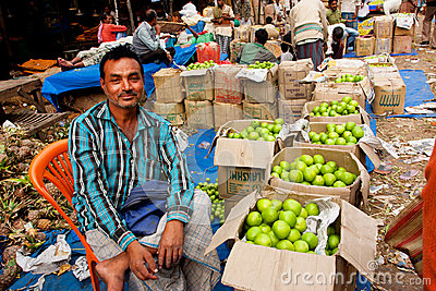 Friendly fruits dealer sell exotic fruits on the colorful city market Editorial Photography