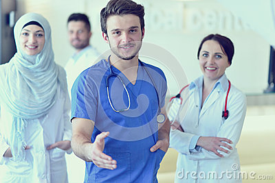 Friendly male doctor with open hand ready for hugging Stock Photo