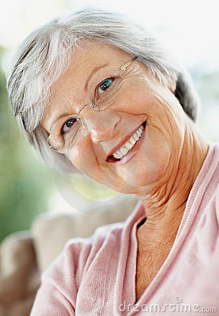 Friendly retired woman giving you a warm smile