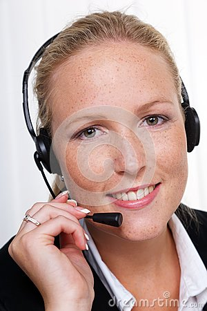 Friendly woman with a headset