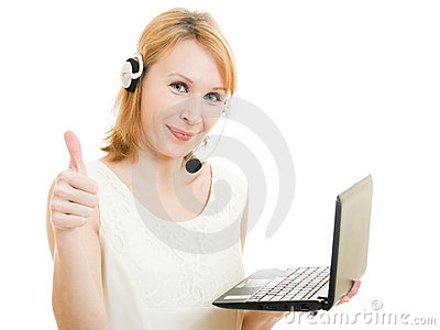 The friendly woman operator with a laptop