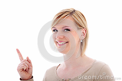 Friendly woman pointing to blank copyspace